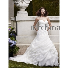 sweetheart neckline Pick-ups on skirt create the illusion of a rose motif Organza wedding gown