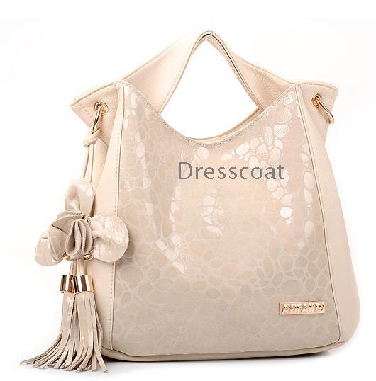... Az új tavaszi kő gabona virágok címer marhabőr női táska han kiadás bőr női  táska dagály ... 8cdf2d86c9